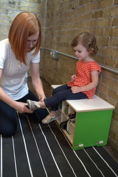 Kids shoe storage bench with eight shoe cubbies.