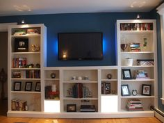 Finished look. IKEA bookcases for family room. IKEA can look nice and look like built ins Ikea Billy Hack, Ikea Billy Bookcase Hack, Built In Bookcase, Billy Bookcases, Bookshelves Ikea, Room Shelves, Bookshelf Pantry, Billy Bookcase With Doors, Leaning Bookshelf