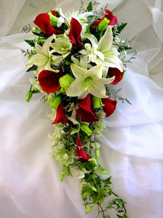 Lush tropical destination wedding bouquet composed of a tropical blend of Casablanca lilies, calla lilies, orchids and roses.