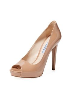 Patent Leather Basic Peep-Toe Pump by Prada at Gilt; Patent leather upper; Covered heel and hidden platform; Leather insole and sole; $750 reflects European retail pricing converted to U.S. Dollars.