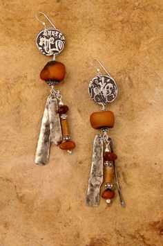 Patricia Reinking - Earrings with old Afghan silver coin, old amber beads, bone and hammered silver dangles. With gold coins and dangles? Amber Beads, Amber Jewelry, Wire Jewelry, Jewelry Crafts, Jewelry Art, Jewelry Design, Jewelry Ideas, Ethnic Jewelry, Jewellery
