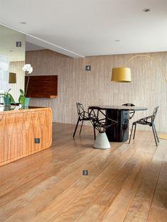 Suite Arquitetos escolhe tons neutros e naturais para apartamento.