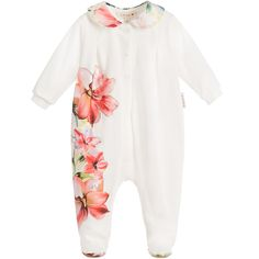 Girls ivory long-sleeved babygrow by Loredana LòLò. Made in a soft stretch cotton jersey, it has popper fasteners on the front and between the legs. It has a beautiful floral print with silver diamanté studs on the peter pan collar, front and soles. <br /> <ul> <li>90% cotton, 10% elastane (soft stretch jersey)</li> <li>Machine wash (30*)</li> <li>Popper fasteners on front & between legs</li> <li>True to size fitting</li> <li>Made in Italy</li> </ul>