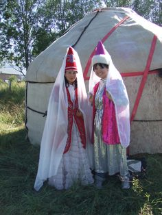 Kyrgyz girls in traditional clothing.