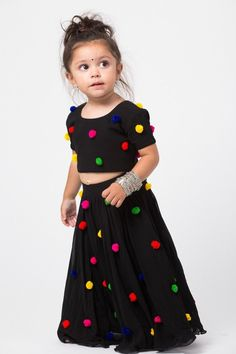 Black Mal cotton lengha with colorful pom pom detail Estimated shipping: weeks Baby Girl Party Dresses, Kids Outfits Girls, Little Girl Dresses, Kids Girls, Girl Outfits, Girls Frock Design, Baby Dress Design, Kids Dress Wear, Kids Gown