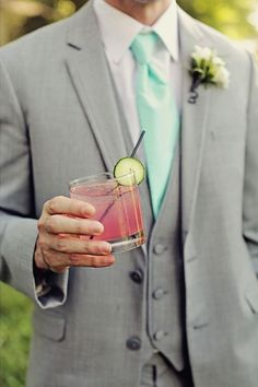 A pink cocktail looks so tasty, and so does this handsome look for this groom rocking his wedding day colors, glacier gray and lucite green! Spring Wedding, Wedding Day, Wedding Stuff, Tuxedo Wedding, Wedding Suits, Wedding Mint Green, Groom And Groomsmen, Groomsmen Outfits, Pink Cocktails