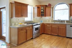 Open kitchen with stainless gourmet appliances