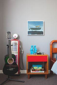 Paint colors that match this Apartment Therapy photo: SW 6868 Real Red, SW 2837 Aurora Brown, SW 6883 Raucous Orange, SW 7069 Iron Ore, SW 6261 Swanky Gray Melbourne Apartment, Industrial Shelving, Kidsroom, Low Key, Drafting Desk, Decoration, House Tours, Retro Fashion, Room Decor