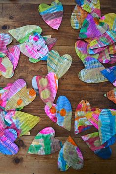 Children paint on newspaper with liquid watercolors, then cut them out into heart shapes to use for Valentine's cards.