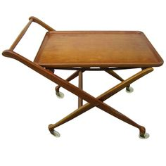 Wonderful Cesare Lacca  Rolling Bar Cart Mid-century Modern | From a unique collection of antique and modern bar carts at http://www.1stdibs.com/furniture/tables/bar-carts/