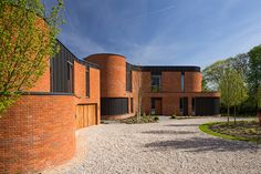 the architecture seeks to celebrate the adaptability of the humble brick with a…