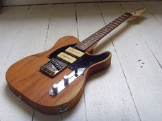 Last but most certainly not least is this triple pickup (Tele bridge + 2 P90s!) tele from The Creamery.  If the headstock was a tele headstock, I wouldn't know what to do with myself.