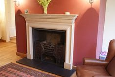 Elegant stone fire surround from The Stone Fireplace Co., York. Hand chiselled from Lincolnshire limestone. Georgian fire basket.