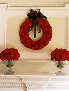 A Passion for Flowers.   I was the first to use carnations back in the 1990′s.   There are three colors of red  in this wreath I made paired with the the Irish Regency crystal filled with matching carnations.