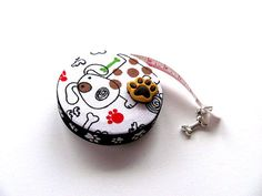 Tape Measure with Dogs and Paws Retractable by AllAboutTheButtons