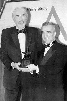 Actor Gregory Peck presents filmmaker Martin Scorsese with the 25th AFI Life Achievement Award in 1997.