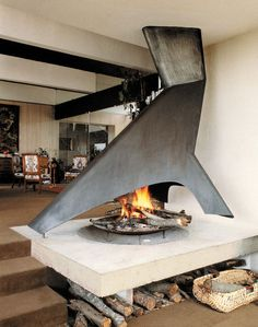 This open fire pit design allows for the chimney to do double duty as a large industrial sculpture.