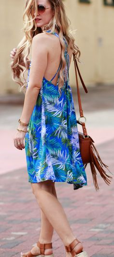 Florida fashion blog styles tropical print dress with strappy low back, flatform espadrilles, and fringe bag for an easy vacation outfit