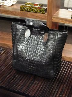 Large tote in caiman crocodile by Celestina in black, or brown:designed by Filipino style icon Tina Maristela-Ocampo, whose exquisite hand-made minaudières utilising Filipino native crafts and materials has bowled-over the fashion consignetti worldwide. now her eponymous brand has branched out into larger day bags and even homewares.