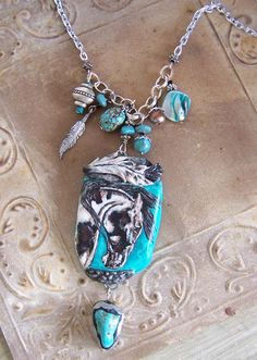 Amulet necklace, art clay handpainted.