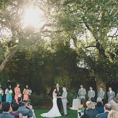 Most of Alexandra and Alejandro's wedding held the fresh lightness of springtime, but the moment they took their vows was full of drama. The sun poked through the trees as the couple held hands and pledged to be true to one another for the rest of their lives. Image Credit: Gina & Ryan Photography