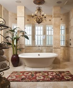 Prepare to step out in European elegance with this unique traditional master bathroom. With oval standalone tub, French patterned tile, and exquisite custom chandelier Andrea Lauren Elegant Interiors brings the old world to South Tampa. Interior Design Gallery, Bathroom Interior Design, Interior Decorating, Classic Home Decor, Classic Interior, Traditional Interior, Master Bathroom, Andrea Lauren, House Design