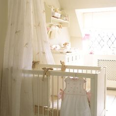 Absolutely beautiful baby girl's nursery. I am loving the neutral color scheme. Such a clean, girly look.