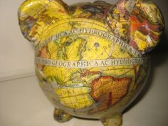 "Old World Map Ceramic Piggy Bank ""Baby Magellan"". $16.00, via Etsy."