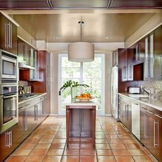 Galley kitchen with saltillo tile floor.
