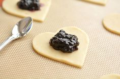 These heart shaped mini blueberry pies are SO EASY and they taste amaaaaazing! They use jam as the filling and you can even use store bought pie crust!