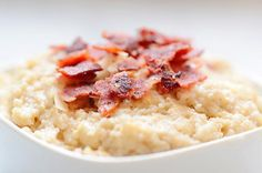 Savory Protein Oats- this oatmeal breakfast recipes adds a savory twist by including turkey bacon and Parmesan cheese. Prepare 3/4 cup dry oats with water according to directions. Cook turkey bacon until crisp. Once oats are cooked, stir in 3 tablespoons of grated Parmesan cheese. Sprinkle chopped bacon crumbles on top and season with pepper. You can use regular or gluten-free oats. CALORIES: 361; PROTEIN: 25 grams.