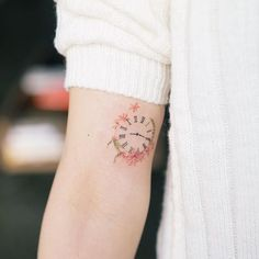 Minimalist clock tattoo