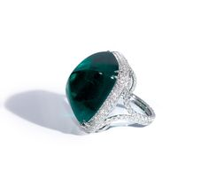 Bayco - A Remarkable 39 carat sugarloaf cabochon colombian emerald set atop an intricate diamond micropave ring.