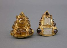 Pair of Ear Ornaments Inlaid with Stones  Period: Central Javanese period Date: Second half of the 8th–second half of the 10th century Culture: Indonesia (Java) Medium: Gold with inlaid stones