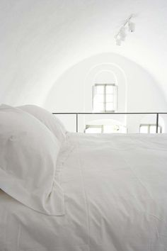 white linens, white #bedroom walls