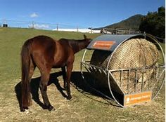 Image result for Covered Round Bale Hay Feeder