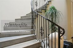 Detail wooden staircase with wrought iron railing  – Image © Sheltered Images / Masterfile.com: Creative Stock Photos, Vectors and Illustrations for Web, Mobile and Print