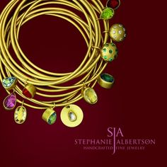 22K gold and gemstone drop bangles from Stephanie Albertson Jewelry