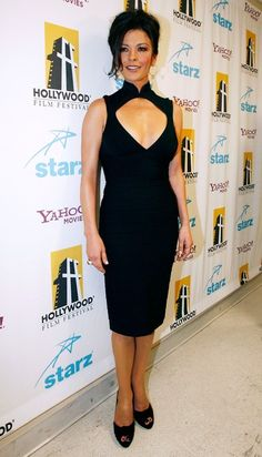 Catherine Zeta-Jones Cocktail Dress - Catherine Zeta Jones showed off her figure in a black cocktail dress with a high-neck and deep v-neck.