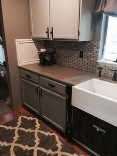 Interesting way of adding a backsplash on end wall.  Useful, especially if tile trim pieces are not available.  Kitchen Remodel: How to Stain Concrete Countertops with Coffee