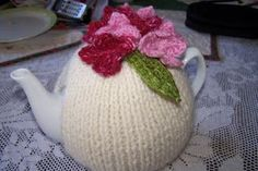 Knitted simple Tea Cosy with roses
