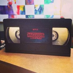 """This lamp in the shape of a Stranger Things VHS tape: 