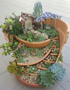 """Broken Pot Miniature Garden - hand crafted country cottage, swing, wishing well, bench, fences and bicycle made from buttons. Available for purchase in Bay Area, CA. VIEW MORE on FB page """"Miniature Memories by Alohalani Ke""""."""