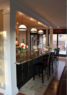 For casual dining or to seperate space in a great room, use lights lowered in the divider to creat an intimate experience, yet keeping communication to the grand picture.