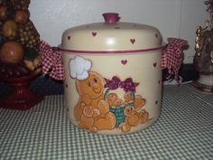 hand painted gingerbread on vintage kettle. By Judy Mullins