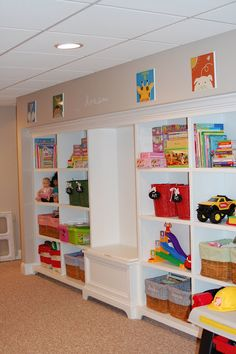 Play room- closet on far end to hide elbow duct from wall to floor cold air return...built ins along rest of wall.