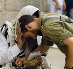 Israeli soldier receiving a blessing.