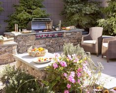 Grill amongst the flowers.  Custom decks, outdoor kitchens, heating, patios, trellises, water features, hardscape and fencing, Lewis Builders can turn your front or back yard into your own personal get-a-way and make you the envy of all your neighbors. - www.lewisbuilder.com