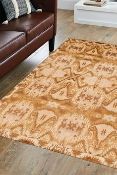 With its dark golden border and large bold designs, this Ikat rug presents itself as a centerpiece of any room it's placed in. The alternating designs outlined in a rich dark brown color distinctively differentiate themselves from the beautiful golden background. #goldrugs #buygoldrugs #buygoldrugsonline #rugknots Golden Background, Dark Brown Color, Oriental Design, Rugs Online, Ikat, Gold Rugs, Centerpiece, Art Pieces, Area Rugs