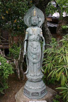 Boddhistatva statue in Japanese garden